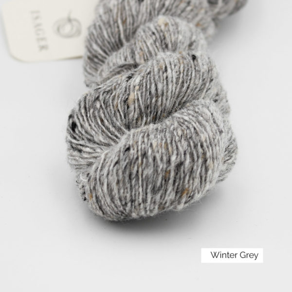 Zoom on a skein of Isager's Tweed in the Winter Grey colorway