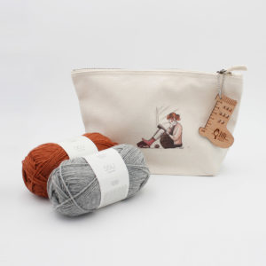 Display of a sock knitting kit made of a limited edition pouch, a needle gauge and 2 balls of Sisu sock yarn