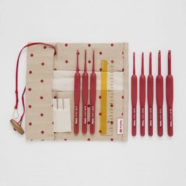 Display of Tulip's Etimo Red Crochet Hooks set, with its fabric pouch and accessories