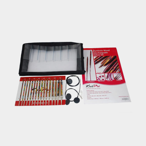 Display of Knit Pro's Symfonie Deluxe set, with its colorful needle tips propped next to the set accessories and organizer