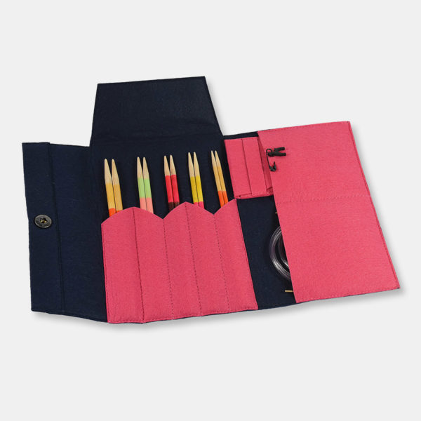 Display of a set of Pony interchangeable circular needles of the Flair type, with maple wood tips, in a pink and navy felted wool case