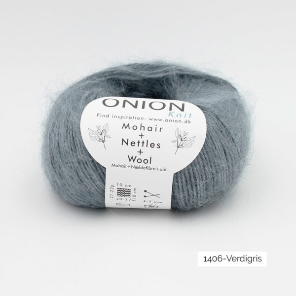 A ball of Onion's Mohair + Nettles + Wool in the Verdigris colorway (greyish light green)