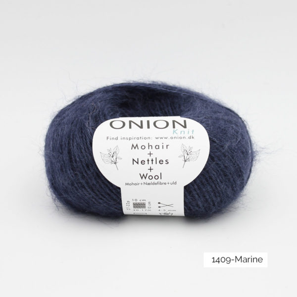 A ball of Onion's Mohair + Nettles + Wool in the Marine colorway (navy blue)
