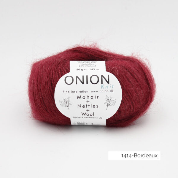 A ball of Onion's Mohair + Nettles + Wool in the Bordeaux colorway (burgundy)