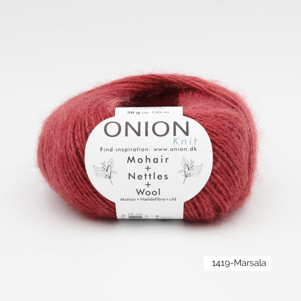 A ball of Onion's Mohair + Nettles + Wool in the Marsala colorway
