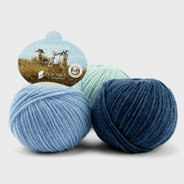 Three balls of Pascuali's Organic Cashmere in assorted shades of blue