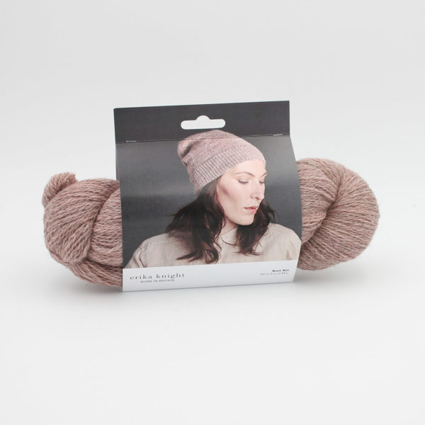 Display of Erika Knight's hat design, specifically made for her Wool Local yarn, printed on a cardboard sleeve