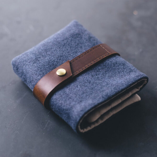 Display of a Twig & Horn interchangeable needle case, made of blue wool and camel leather, closed