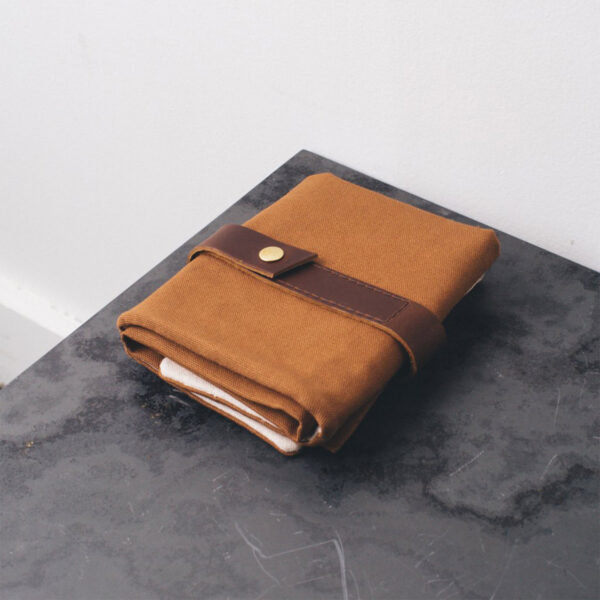 Display of a Twig & Horn interchangeable needle case, made of camel canvas and leather, closed