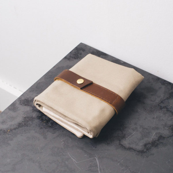 Display of a Twig & Horn interchangeable needle case, made of khaki canvas and camel leather, closed