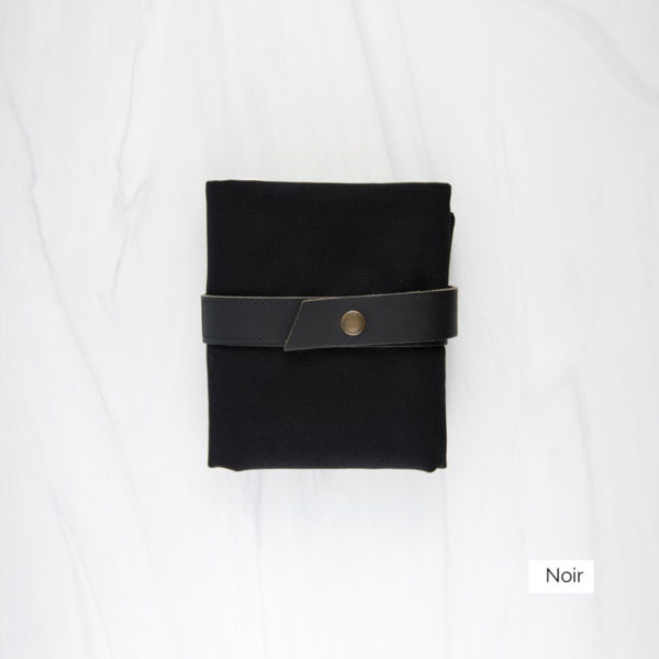 Display of a Twig & Horn interchangeable needle case in the Noir colorway, made of black canvas and brown leather, closed