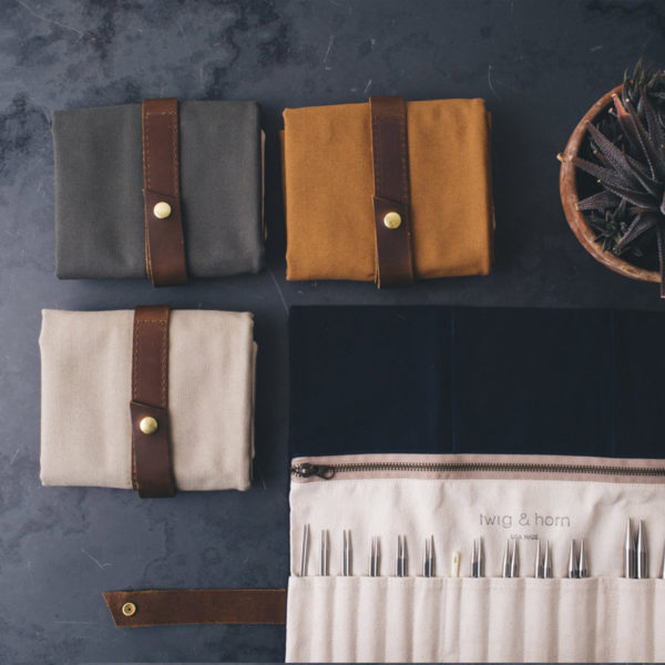 Display of 4 Twig & Horn interchangeable needle cases, one opened and three closed, in assorted colours