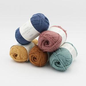 5 balls of Sandnes Garn's Tynn Merinoull in assorted colours