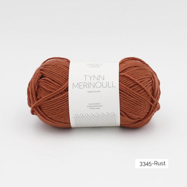 Une pelote de Tynn Merinoull de Sandnes Garn coloris Rust (brun rouge clair)