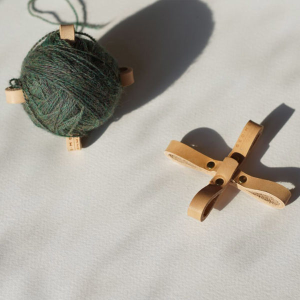 Display of two Turtles by Geo-metry in the tan colorway, one full of yarn and the other empty