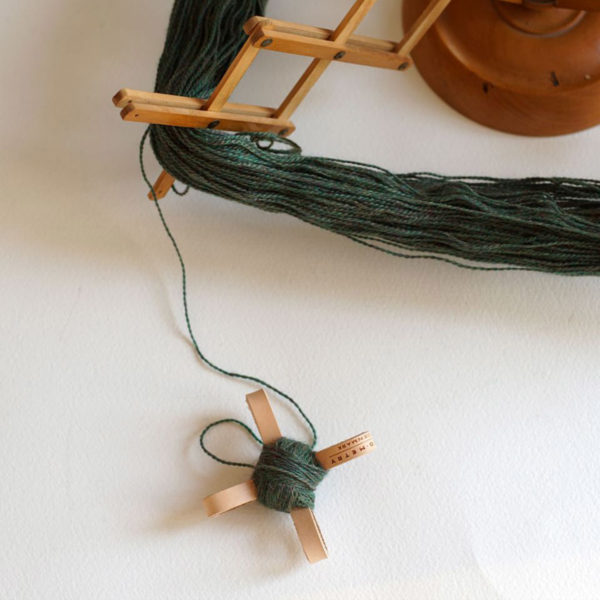Display of a Turtle by Geo-metry, in the tan colorway, with some yarn on it