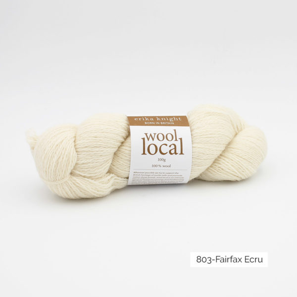 A skein of Erika Knight's Wool Local in the Fairfax Ecru colorway (off white)