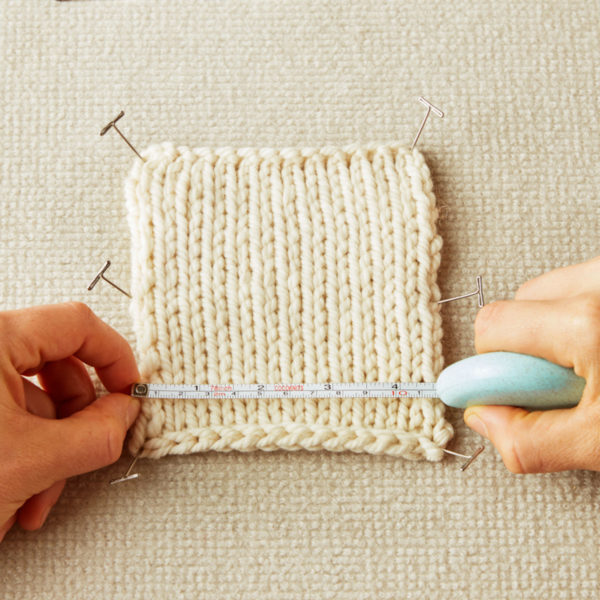 Display of a retractable and eco-friendly tape measures, designed by Cocoknits, used to measure the width of a knitted piece of fabric