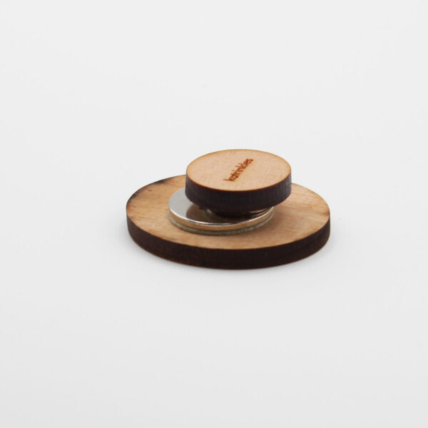 Display of the underside of a wooden needle minder by Katrinkles