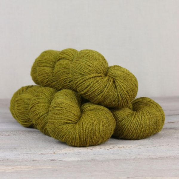 Three skeins of the Fibre Co.'s Amble sock yarn in the Buttermere colorway