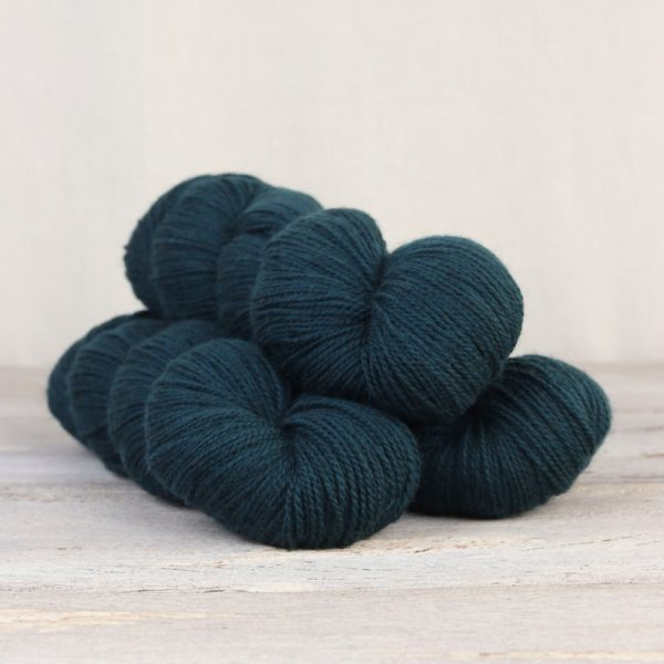 Three skeins of the Fibre Co.'s Amble sock yarn in the Eden Valley colorway