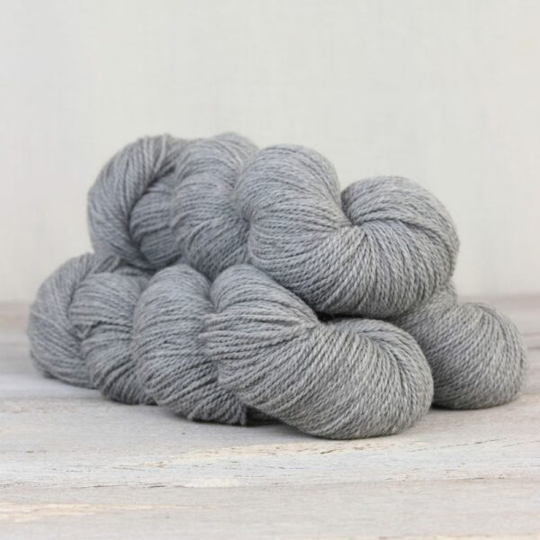 Three skeins of the Fibre Co.'s Amble sock yarn in the Isel colorway