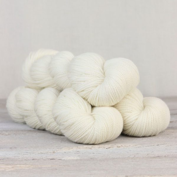 Three skeins of the Fibre Co.'s Amble sock yarn in the White Heather colorway