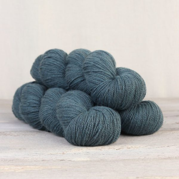 Three skeins of the Fibre Co.'s Amble sock yarn in the Windermere colorway