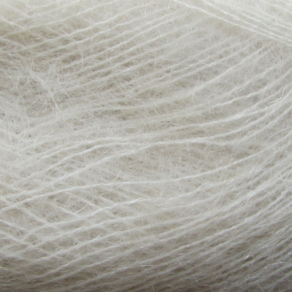 Zoom on a ball of Isager's Silk Mohair in the Natural colorway