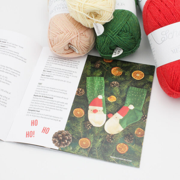 A view of the Santa Claus socks to be knitted with our kit, with the Pretty Little Things photo and the balls of yarn included in the kit