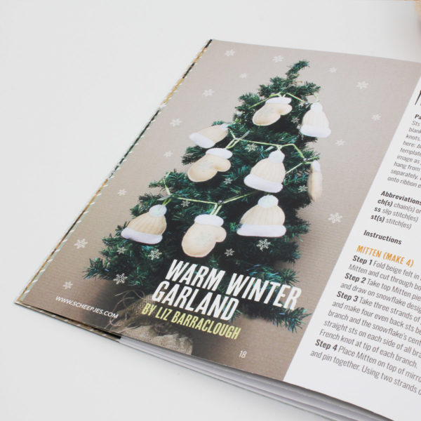 A photo of the Warm Winter Garland by Liz Barraclough, published in the n°10 magazine of Pretty Little Things by Scheepjes