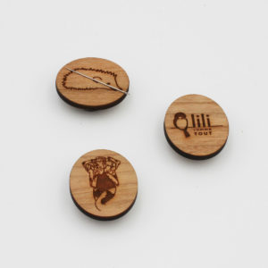 Display of three wooden needle minders created by Katrinkles