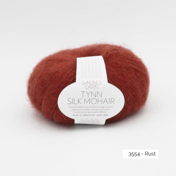 A ball of Sandnes Garn's Tynn Silk Mohair in the Rust colorway