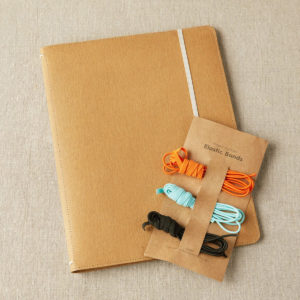Display of Cocoknits' project Portfolio, closed, and its alternative elastic bands