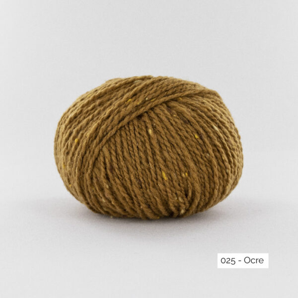 A ball of Super Tweed by Fonty in the Ochre (025) colorway