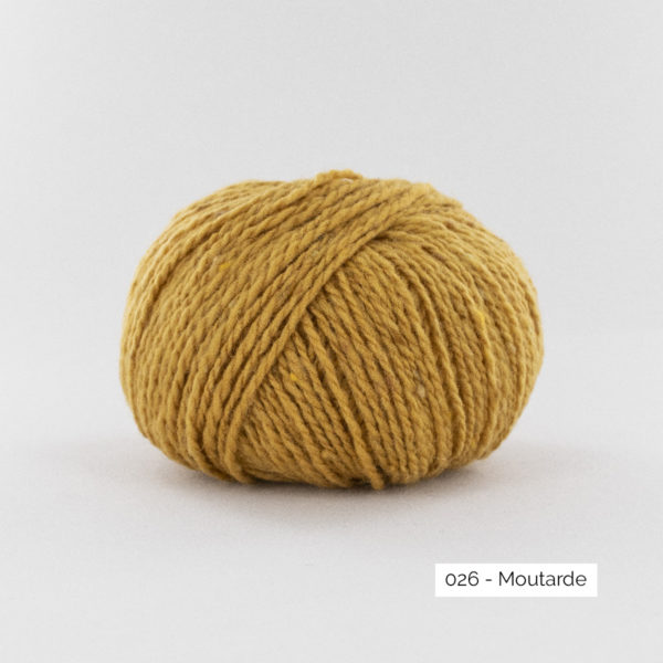 A ball of Super Tweed by Fonty in the Mustard (026) colorway