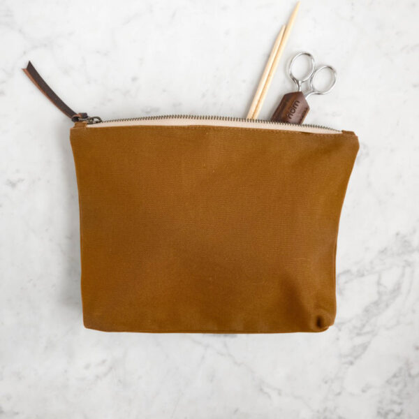 Display of an accessory pouch by Twig & Horn in the Camel colorway
