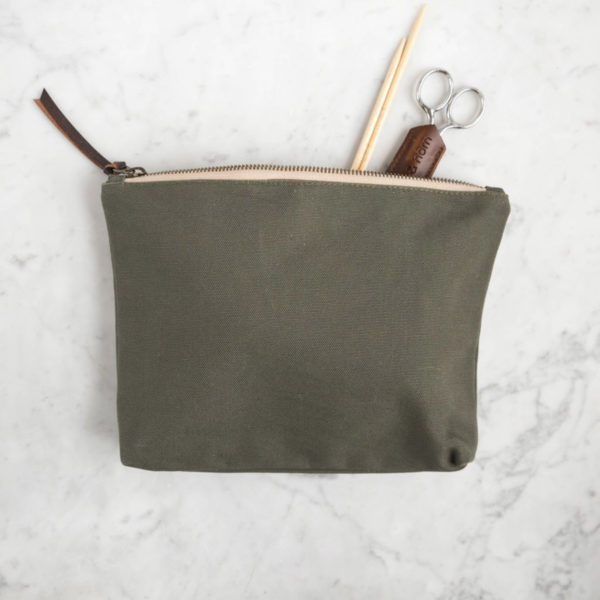 Display of an accessory pouch by Twig & Horn in the Olive colorway