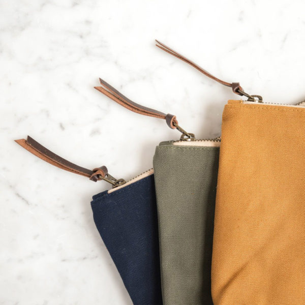 Display of three accessory pouches by Twig and Horn in assorted colours
