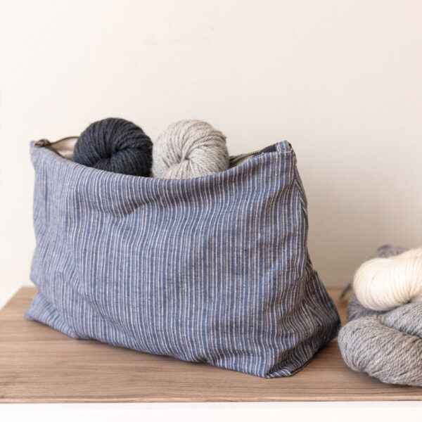 Display of a striped large project pouch made of hemp and cotton by Twig & Horn