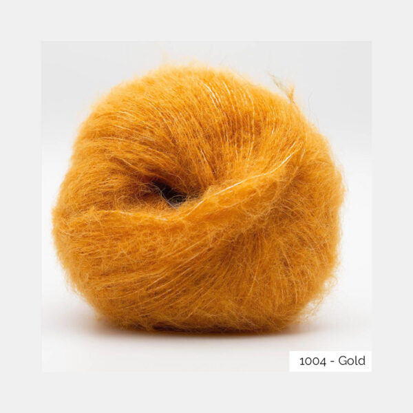 A ball of Baby Silk Fluffy by Kremke Soul Wool in the Gold colorway