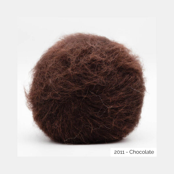 A ball of Baby Silk Fluffy by Kremke Soul Wool in the Chocolate colorway