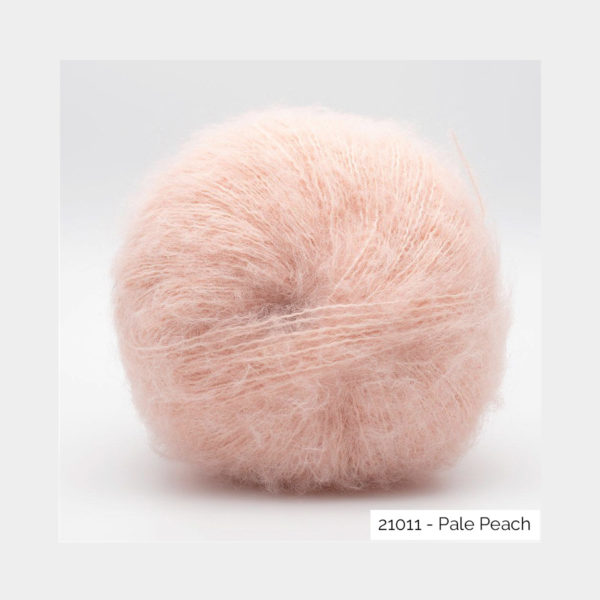 A ball of Baby Silk Fluffy by Kremke Soul Wool in the Pale Peach colorway