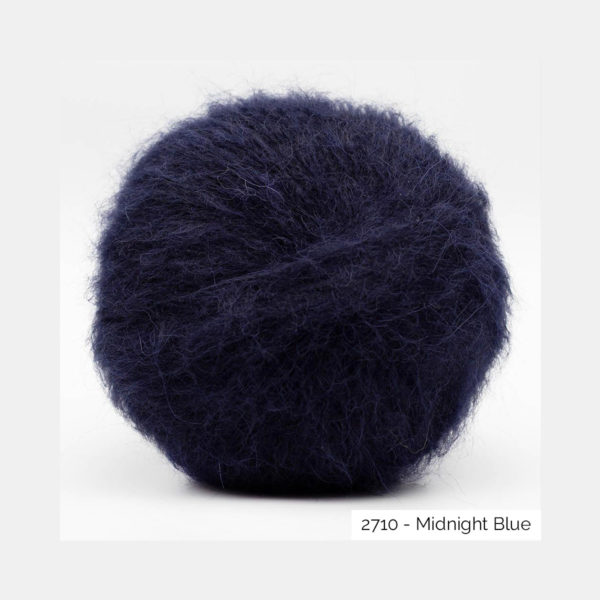 A ball of Baby Silk Fluffy by Kremke Soul Wool in the Midnight Blue colorway