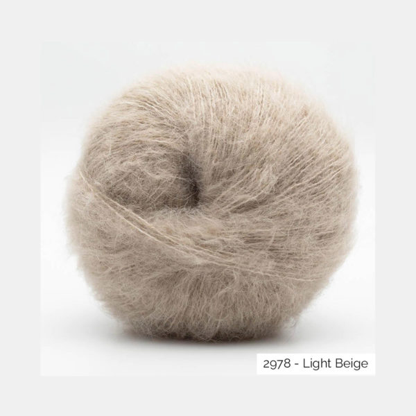 A ball of Baby Silk Fluffy by Kremke Soul Wool in the Light Beige colorway