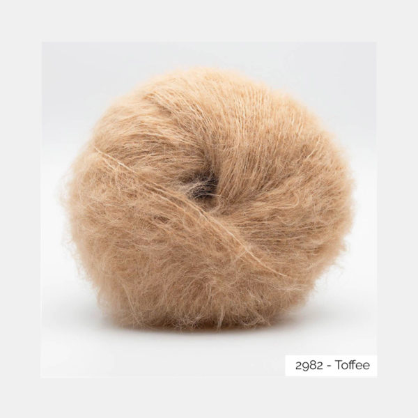 A ball of Baby Silk Fluffy by Kremke Soul Wool in the Toffee colorway