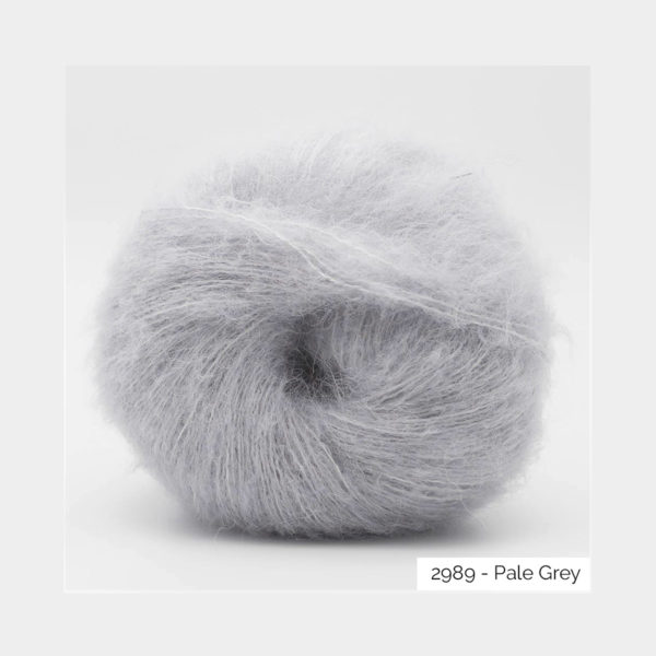 A ball of Baby Silk Fluffy by Kremke Soul Wool in the Pale Grey colorway