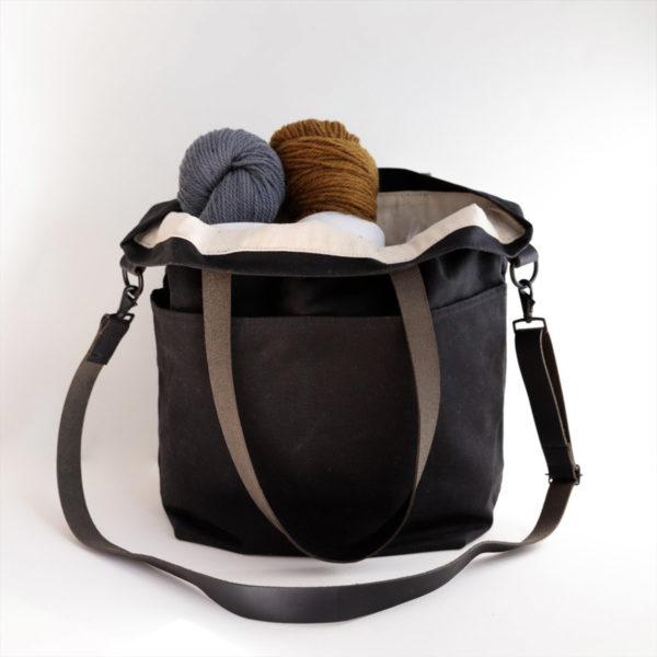 Display of a Waxed Crossbody bag by Twig & Horn in the Charcoal colorway