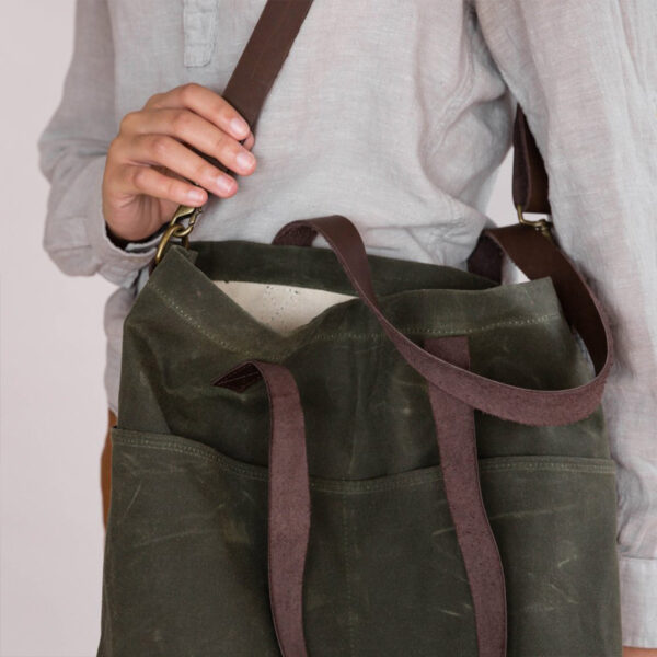 Display of a Waxed Crossbody bag by Twig & Horn in the Olive colorway