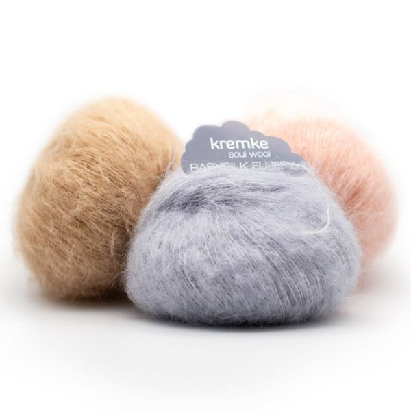Display of three balls of Baby Silk Fluffy by Kremke Soul Wool in assorted colours